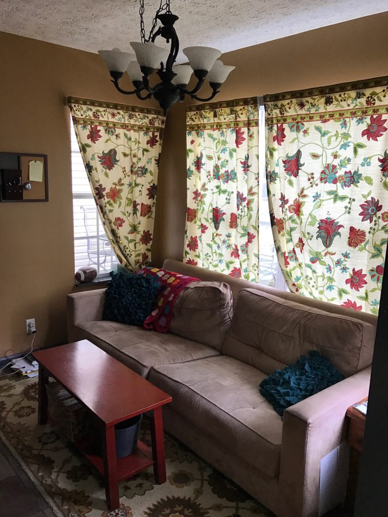 brown sofa in dark living room