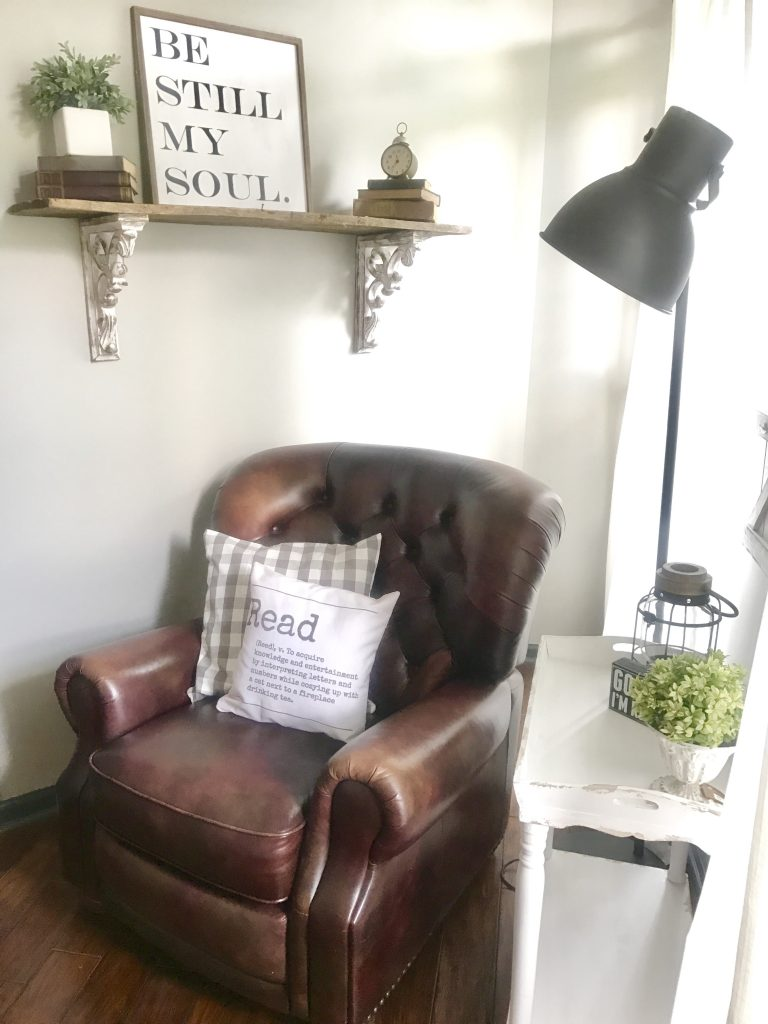 brown leather chair in reading nook