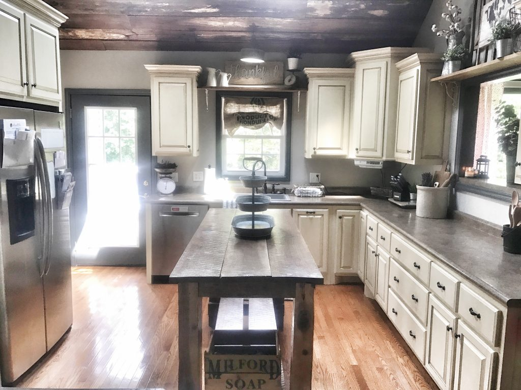 farmhouse style kitchen with wooden ceiling