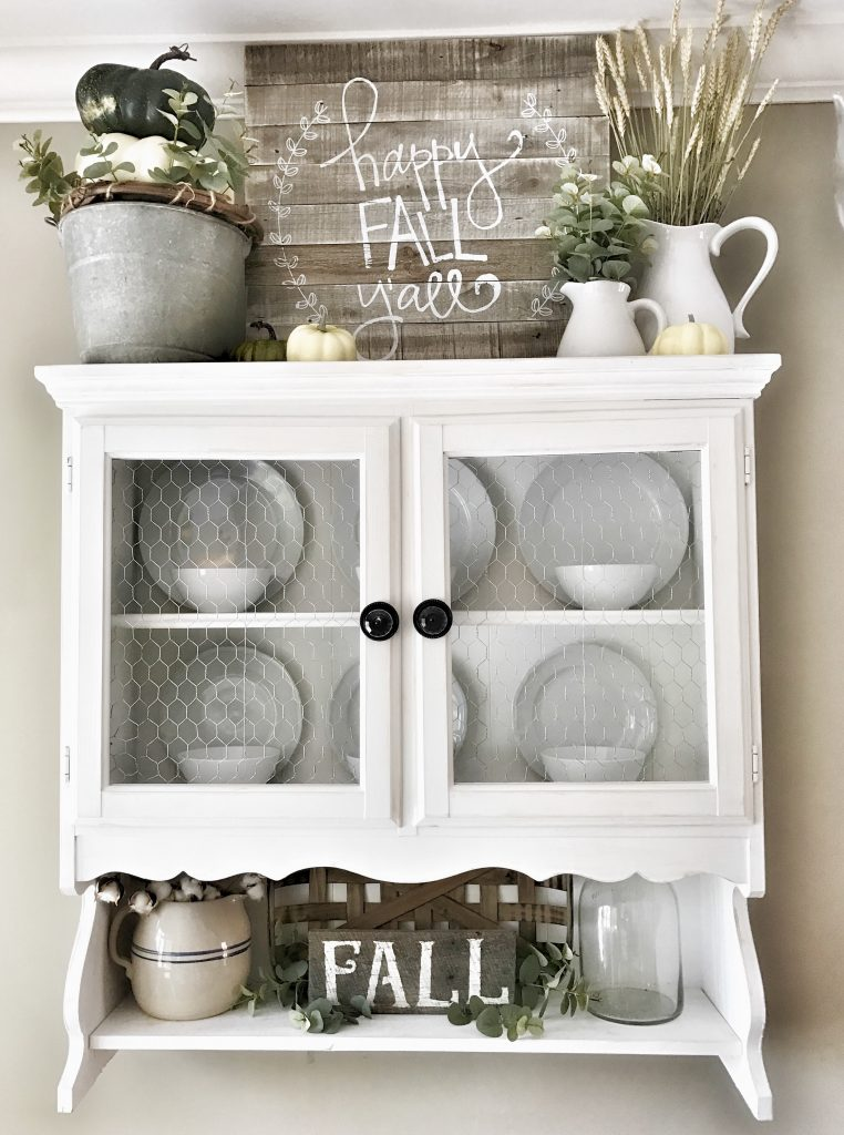 hanging hutch decorated with fall decor