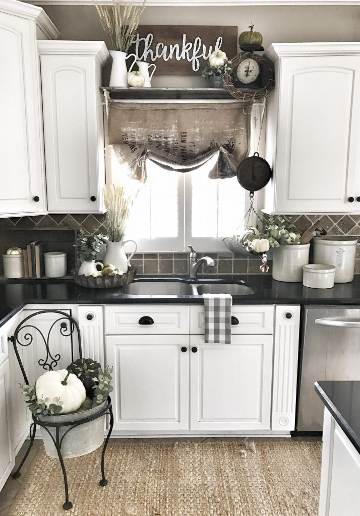 farmhouse kitchen sink area with fall decor