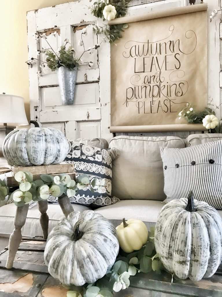finished scroll sign in background of fall decor
