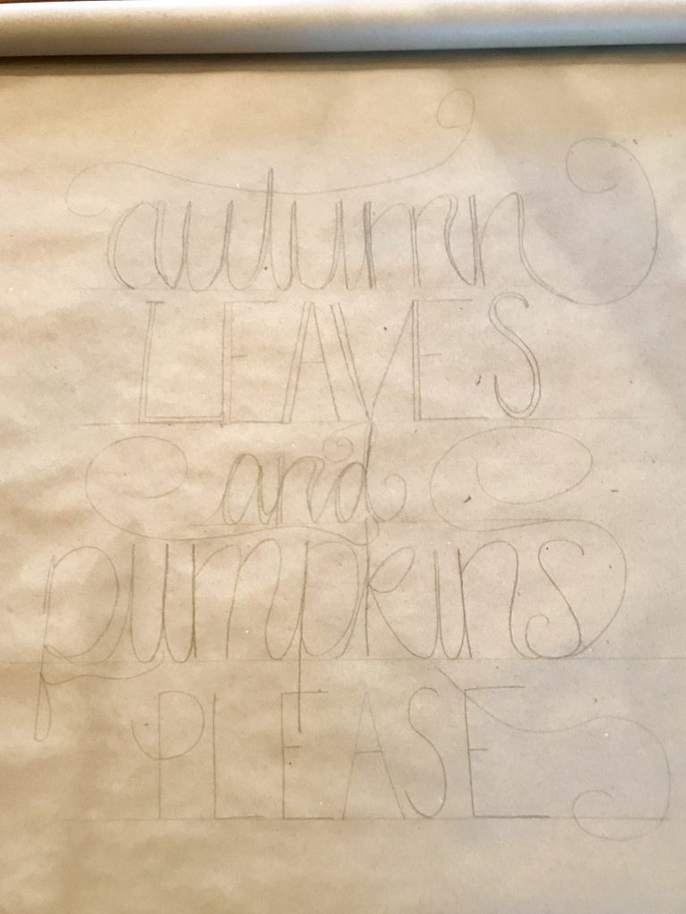 scroll sign with the words autumn leaves and pumpkins please written in pencil