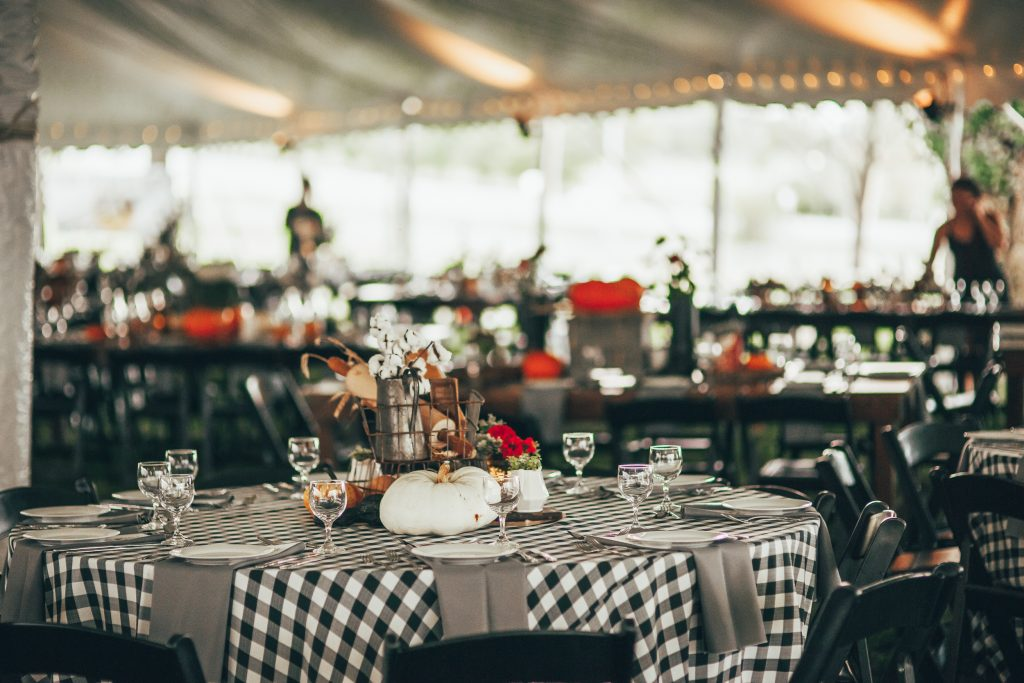 table decorated for fall with black and white checkered tablecloth