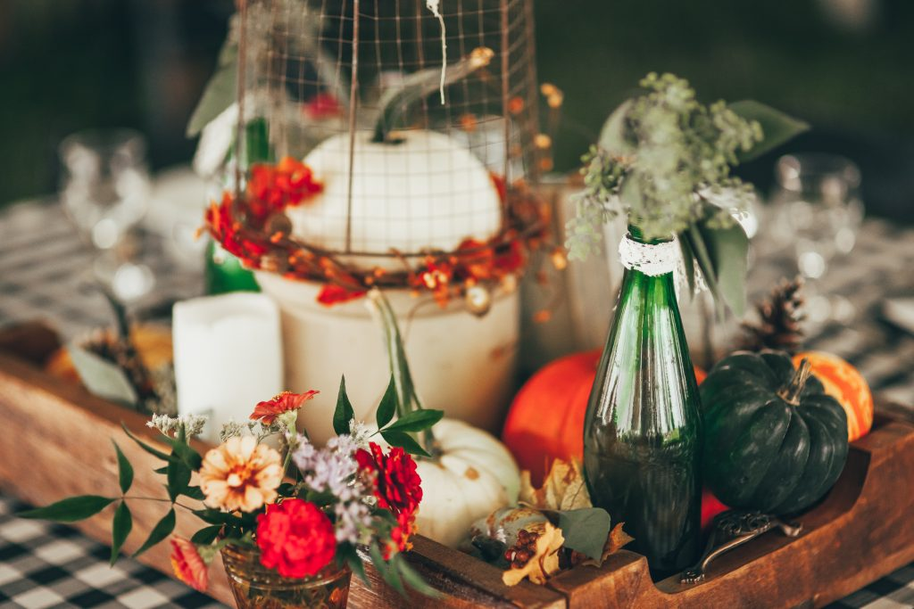 fall vignette with white pumpkins in wooden piece