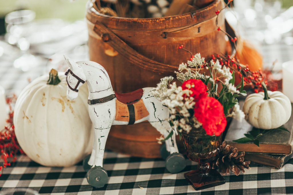 close up of small white wooden horse in centerpiece