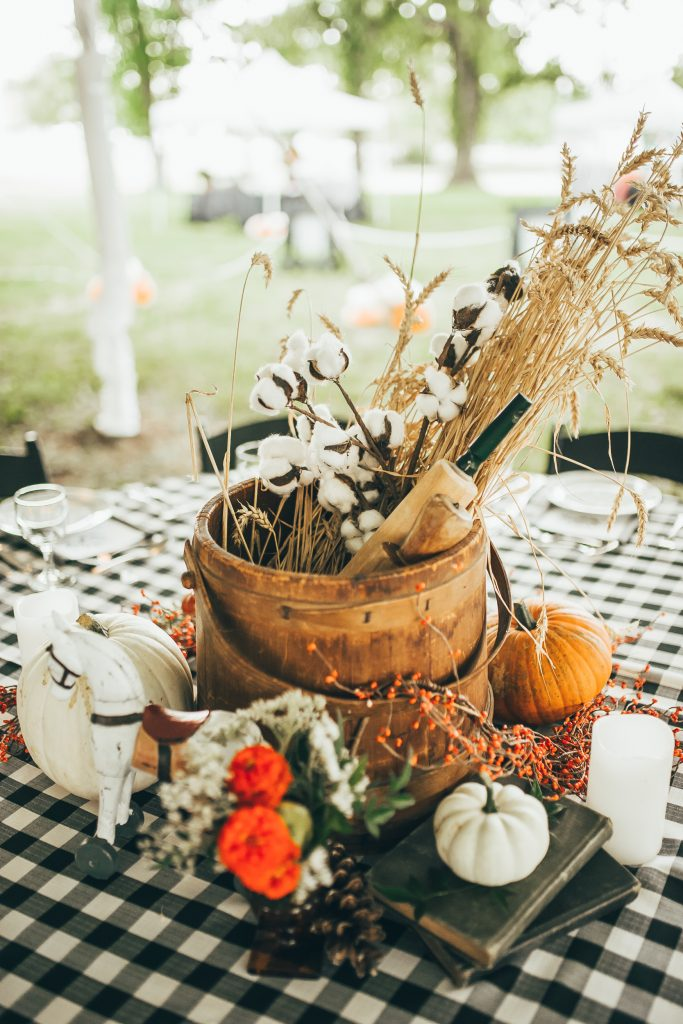 beautiful fall centerpiece with wheat, cotton, and pumpkins
