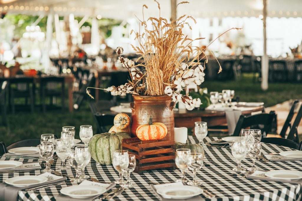 fall table with copper pot centerpiece with wheat and pumpkins