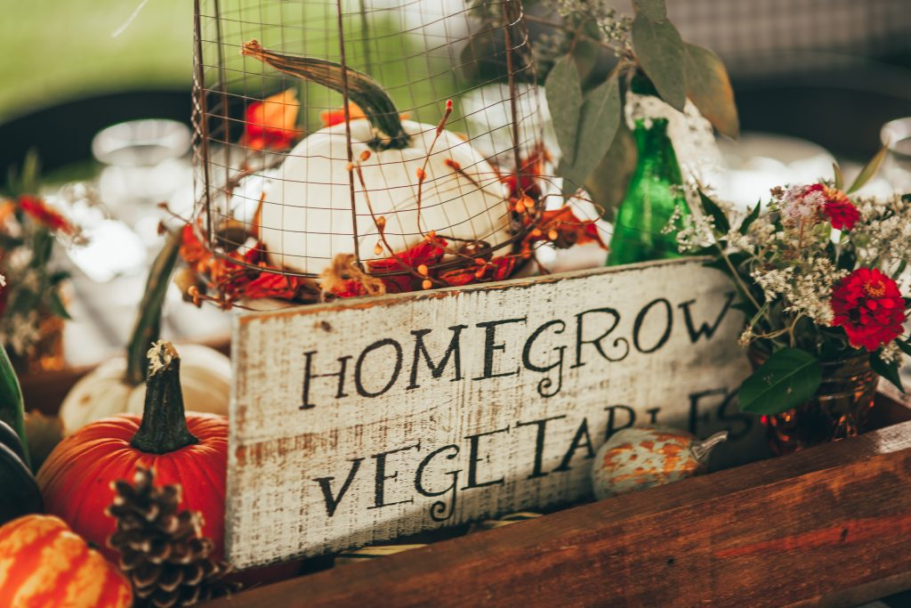 close up of fall centerpiece with vintage homegrown vegetables sign