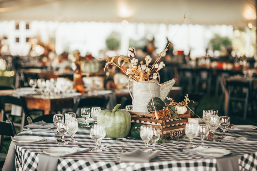 fall centerpiece with vintage pitcher and green pumpkins