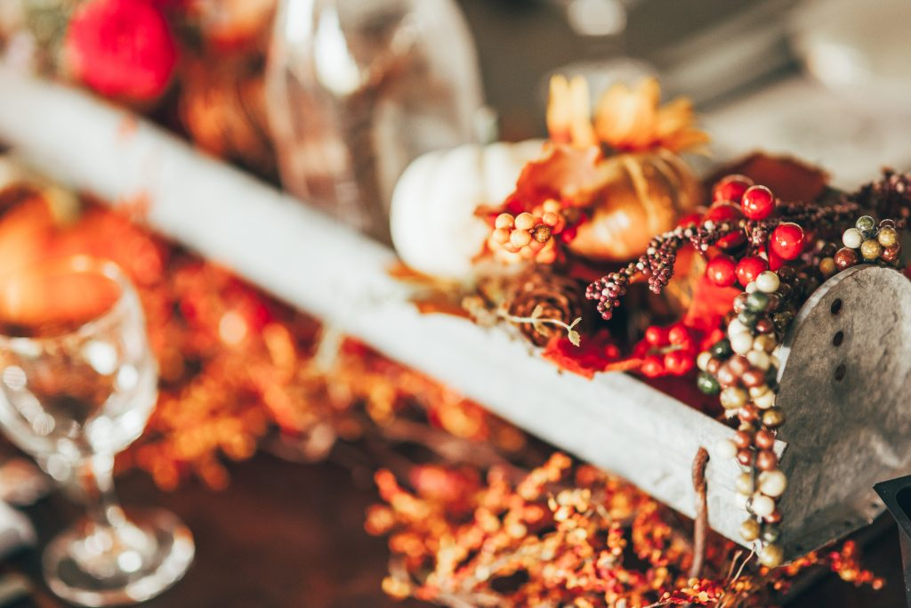 close up of fall centerpiece with orange and red colors