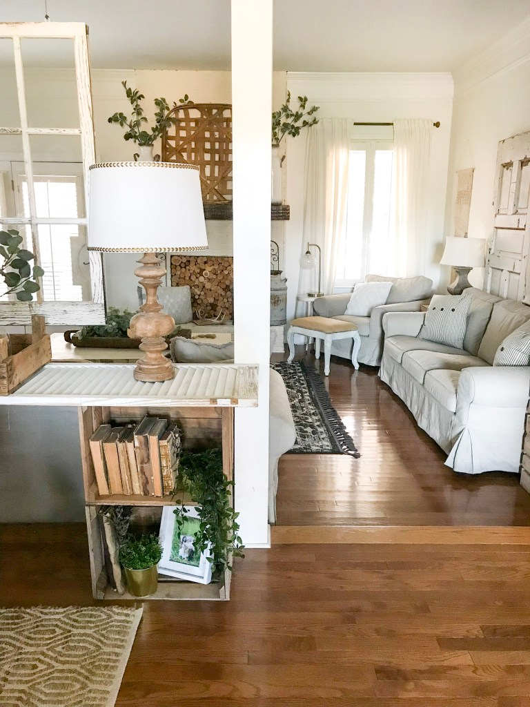 farmhouse living room with faux greenery