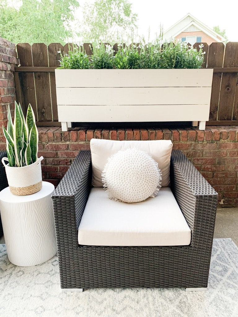 chair with side table and large planter box