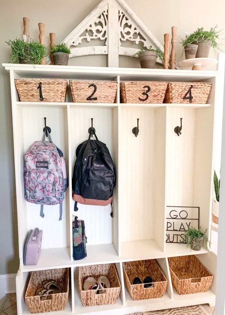 kid's backpacks hanging in cubbies