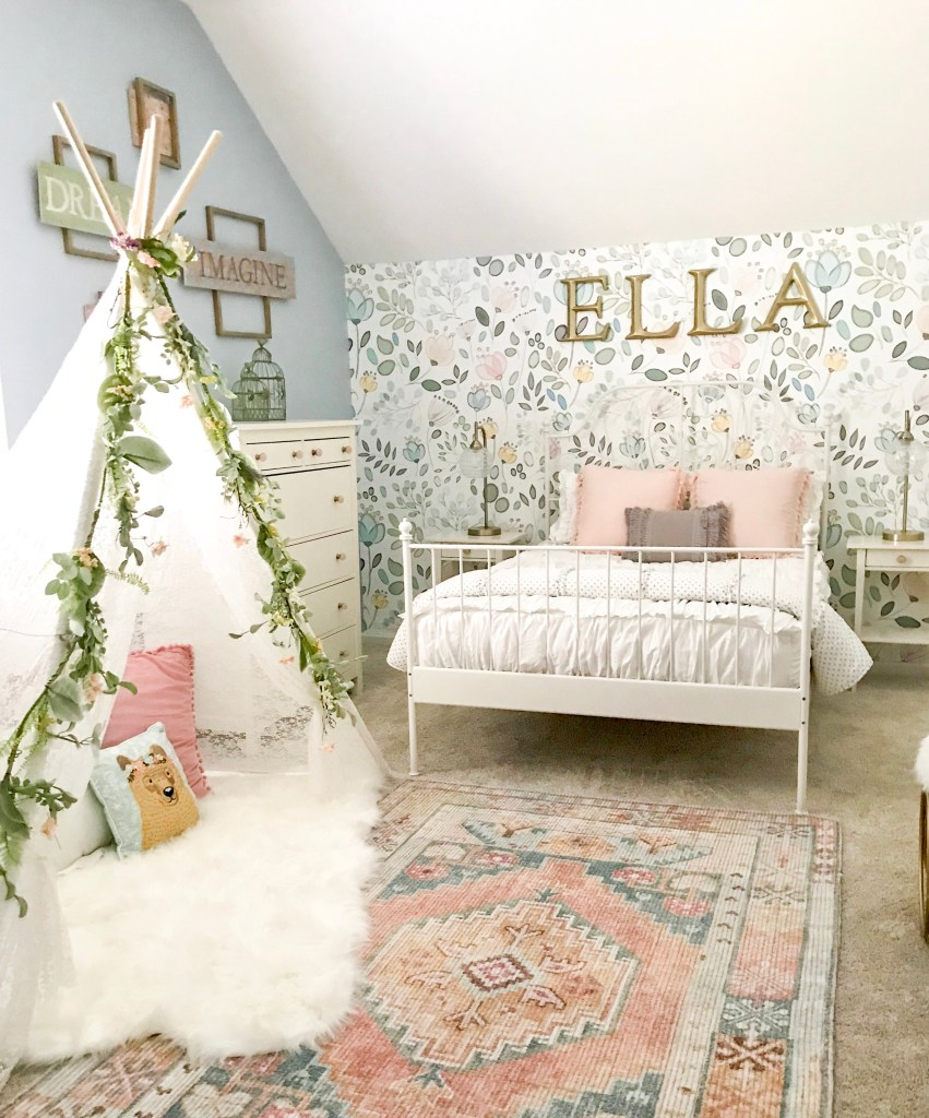 girl's room with floral wallpaper