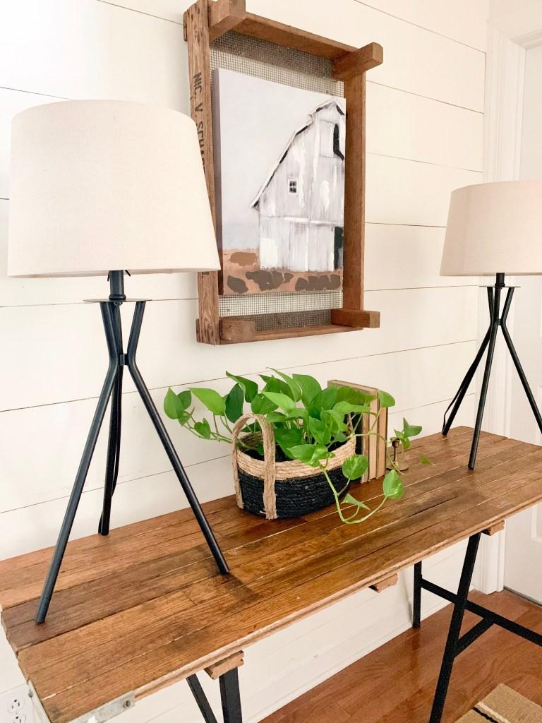 black tripod lamps on modern farmhouse entryway table