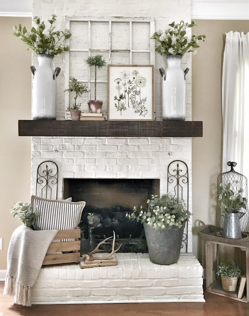 fireplace with mantel decorated