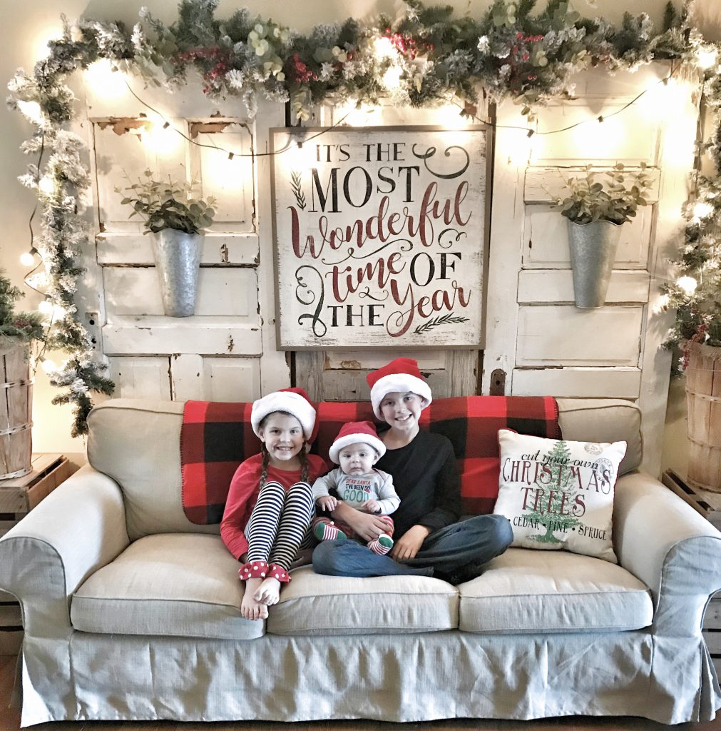 children on couch in Christmas decorated room