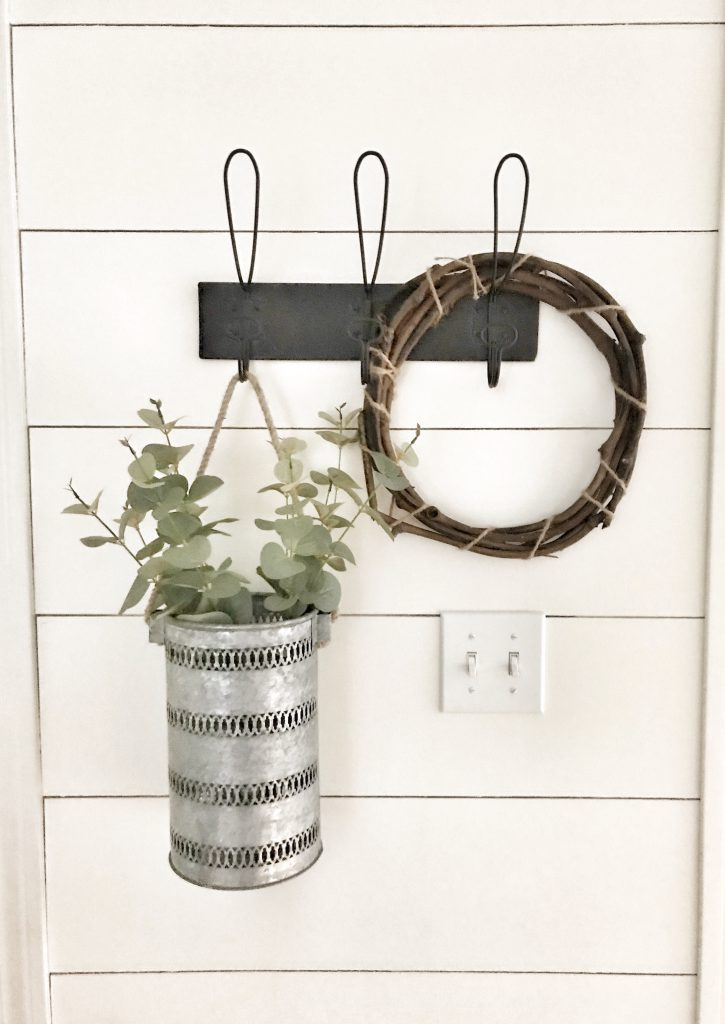 hanging plant in metal basked and wooden wreath