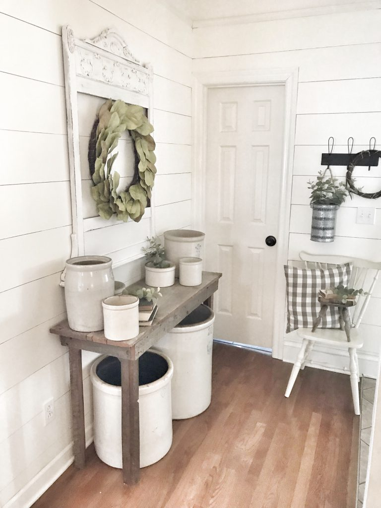 side view of farmhouse hallway with faux shiplap walls