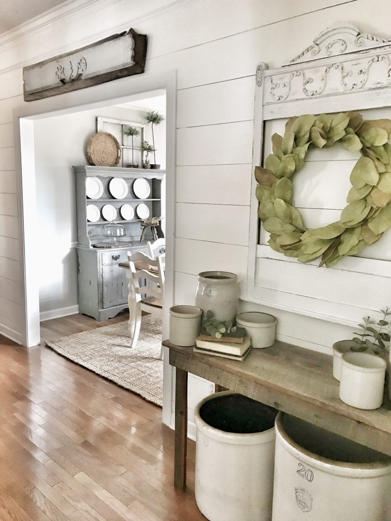 farmhouse hallway with planked white walls