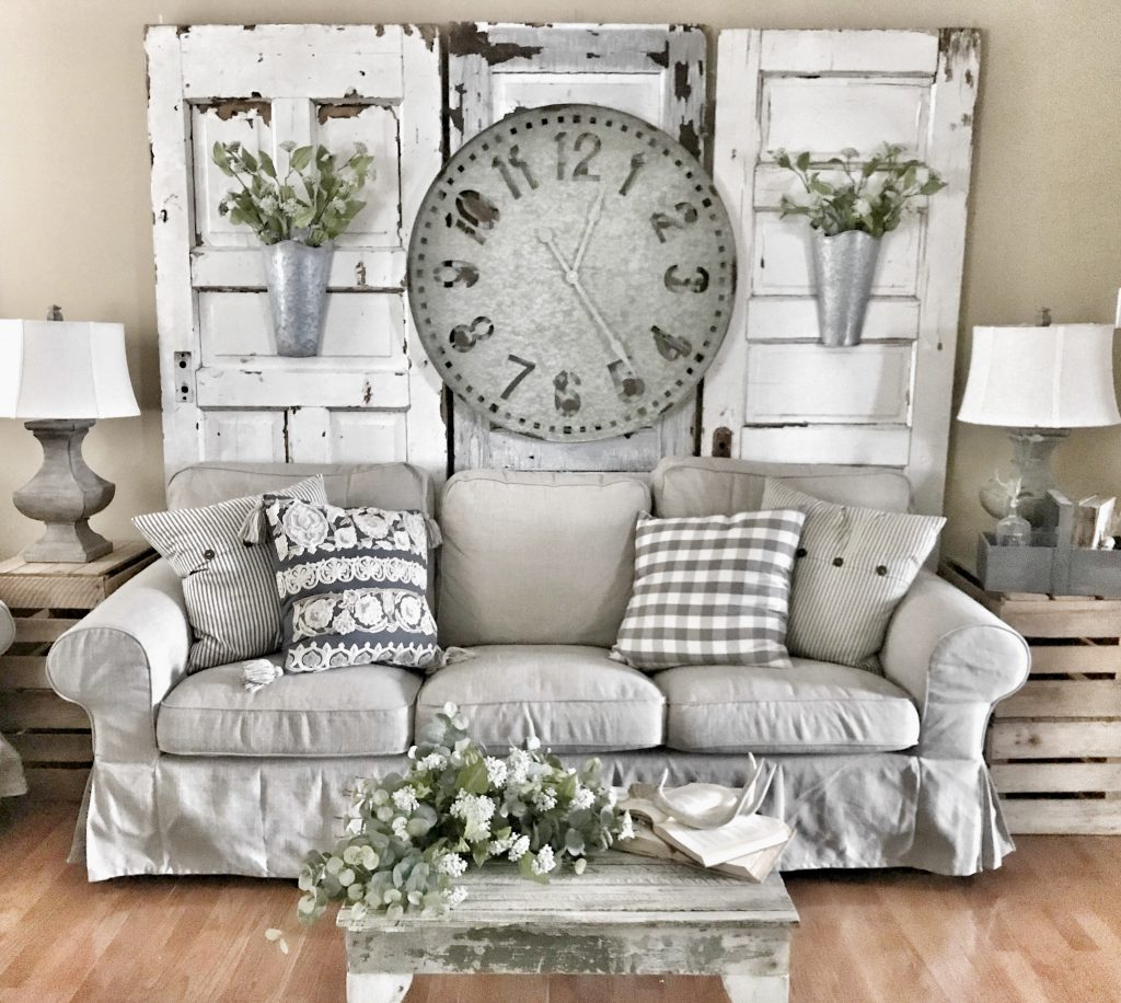 farmhouse wall clock hung in living room