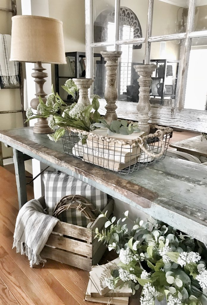 farmhouse console table decorated with old books
