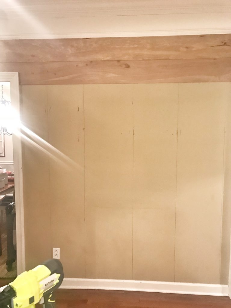 faux shiplap boards being hung