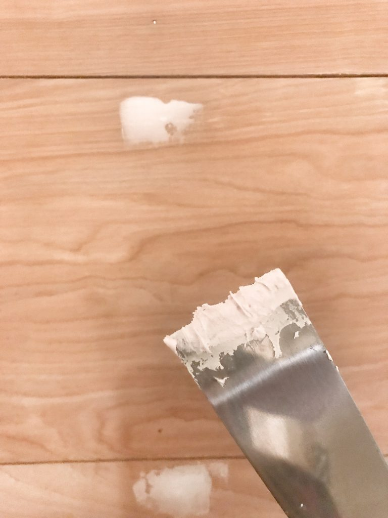 close up of spackle applied to shiplap nail holes