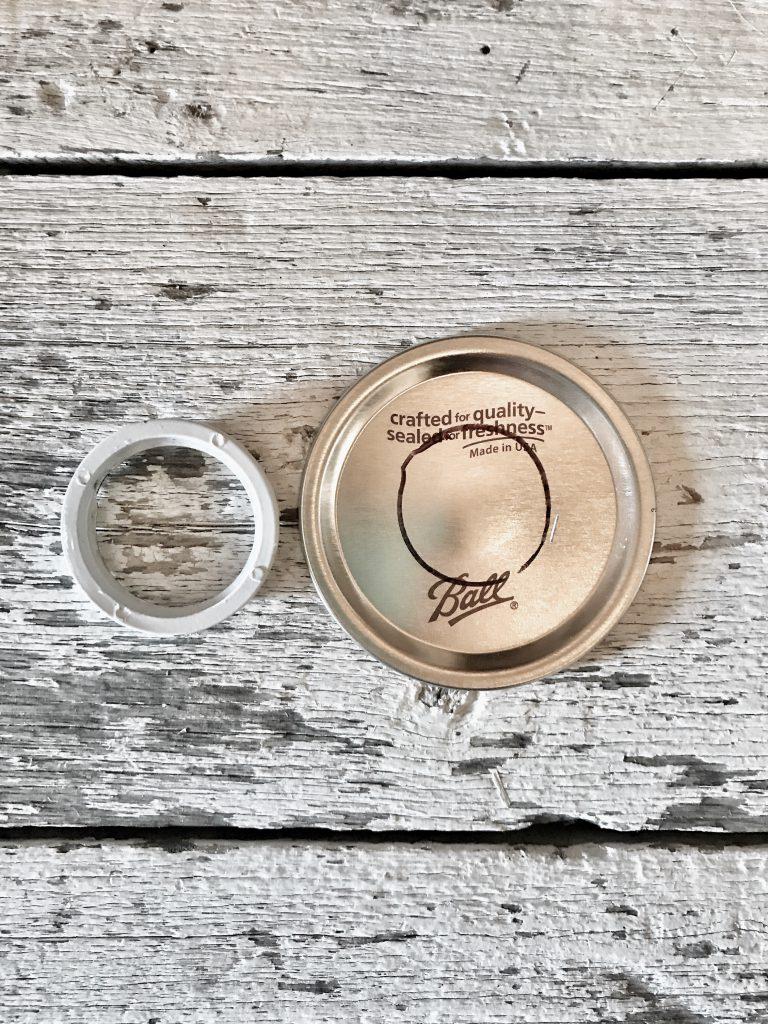 mason jar lid marked for hole