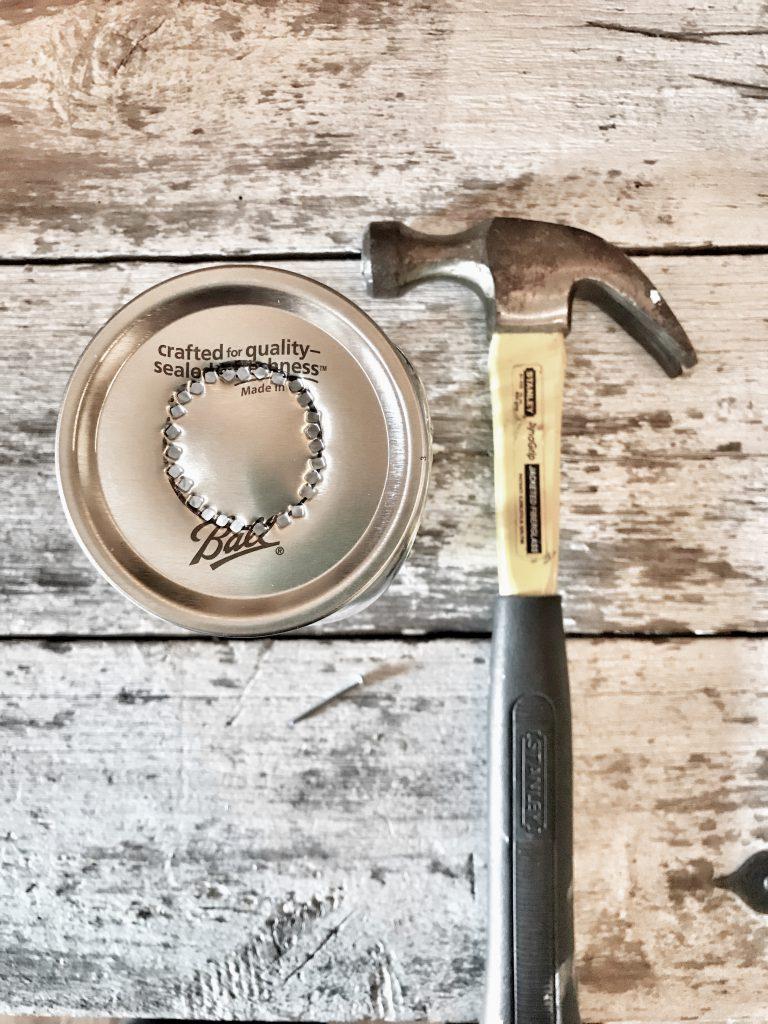 hammer beside mason jar top