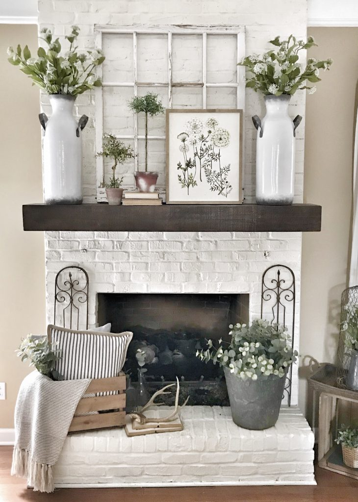 pottery barn shelf used as a mantel