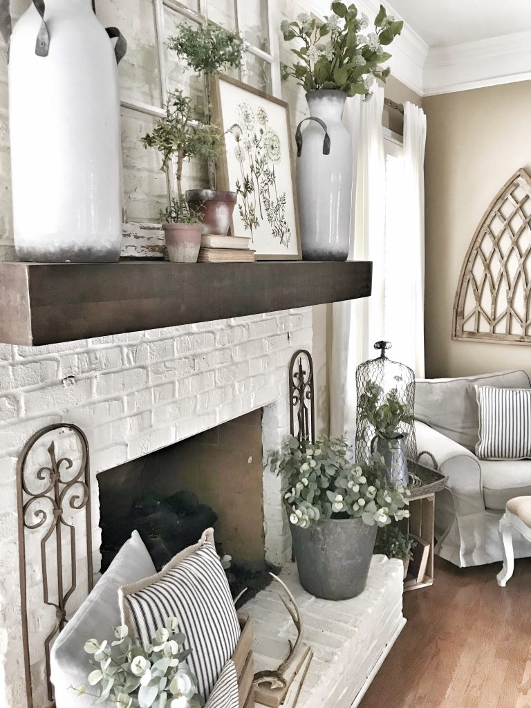 white fireplace with pottery barn shelf as mantel