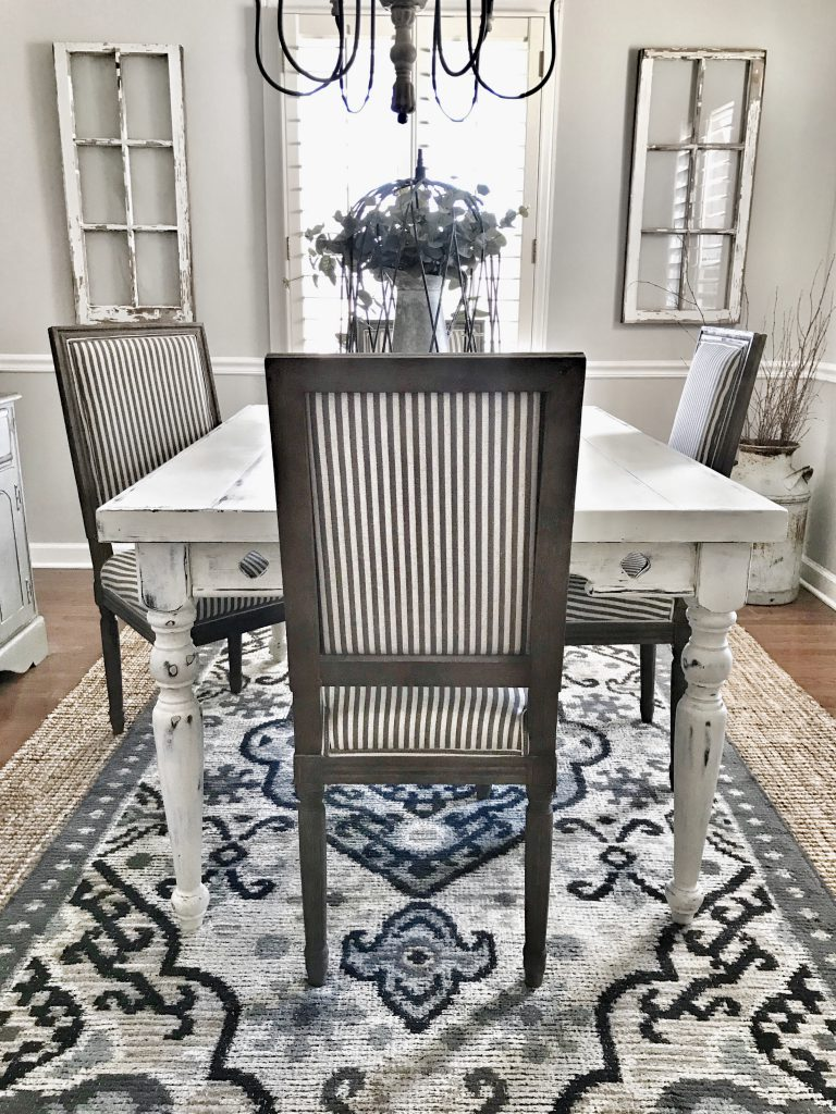 dining room table and chairs on rug