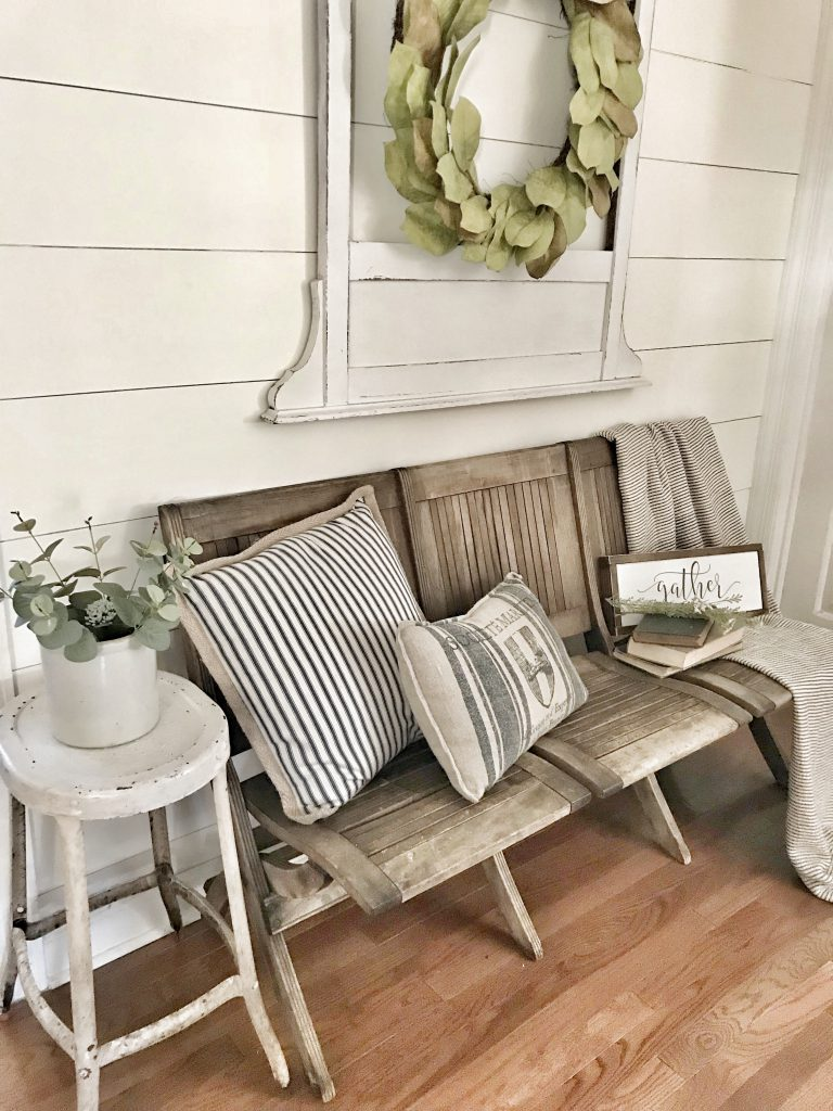 antique church pew with pillows