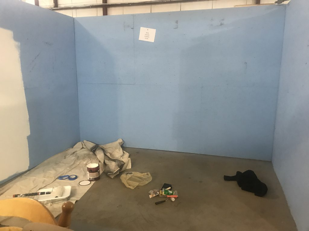 empty antique booth blue walls