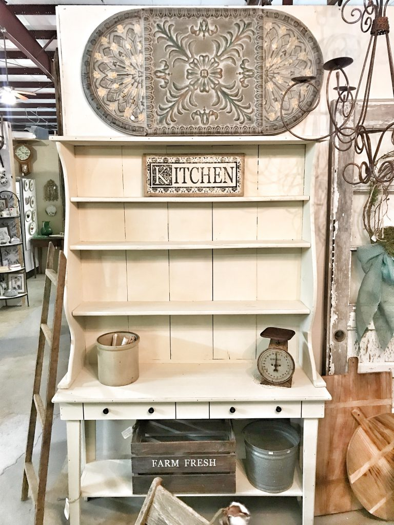 antique hutch with farmhouse decor