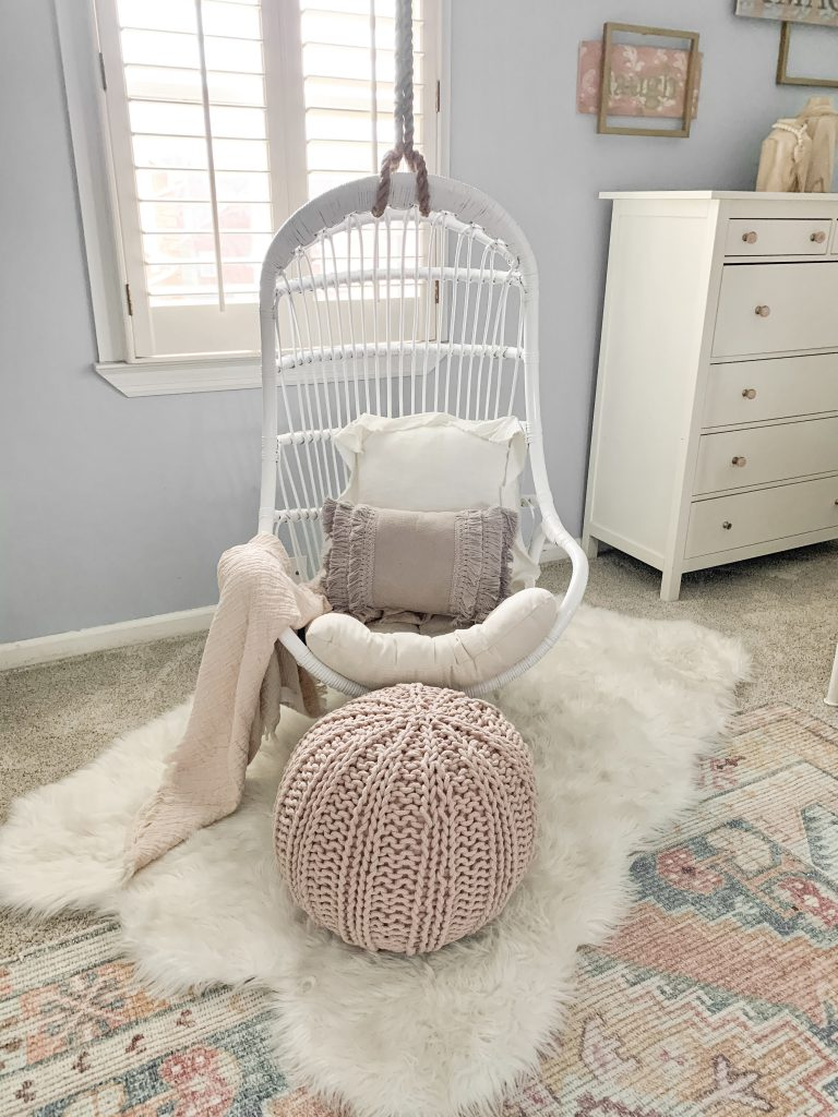 white swing chair in front of window