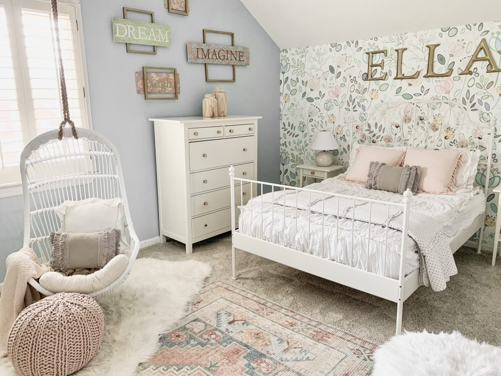 metal bed with floral wallpaper
