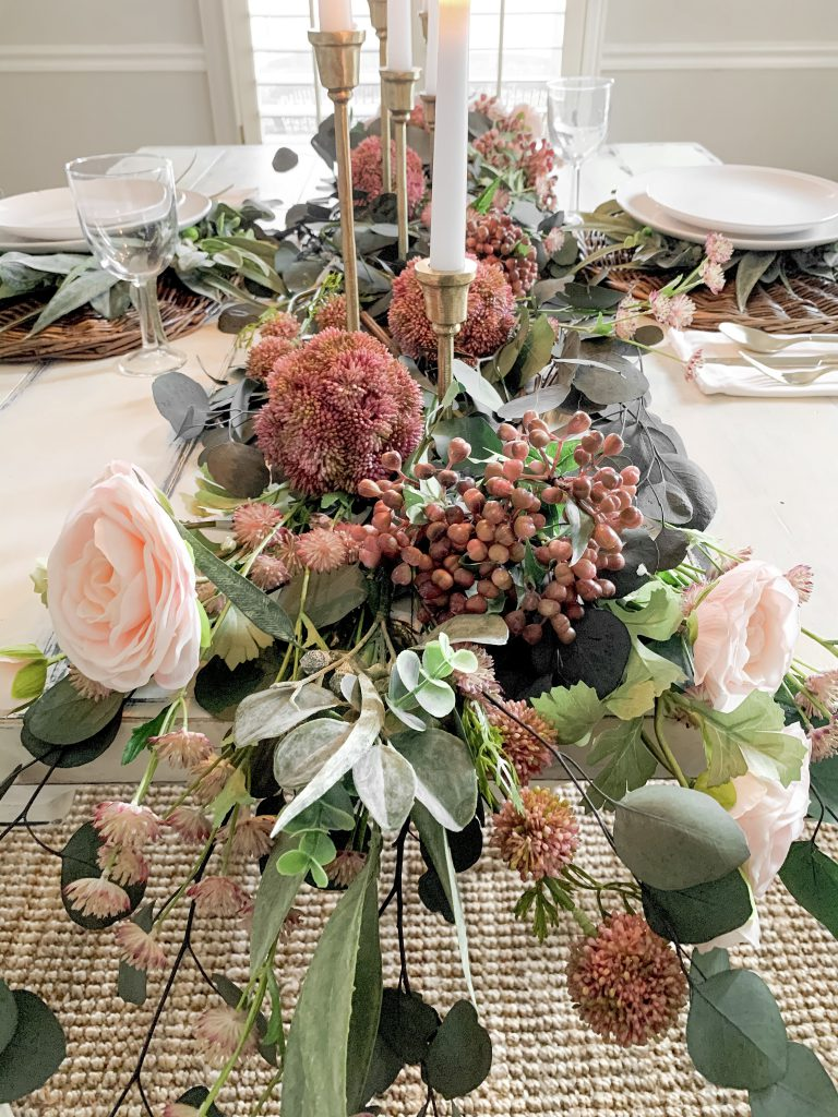 pink florals draping off of dining room table