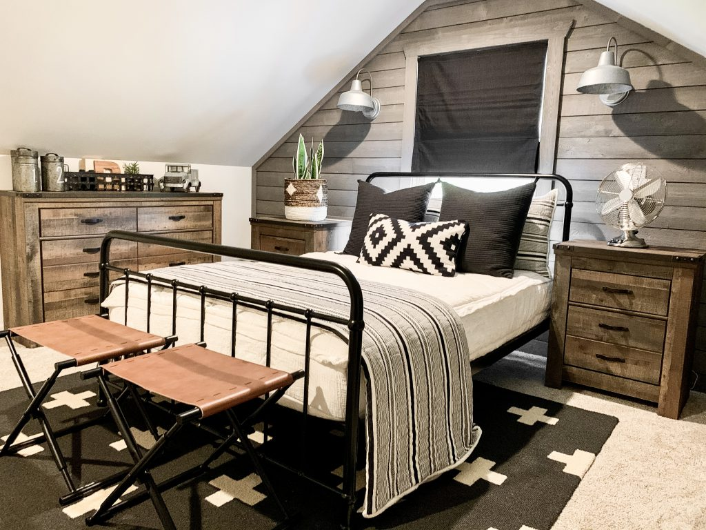 black metal bed with leather benches