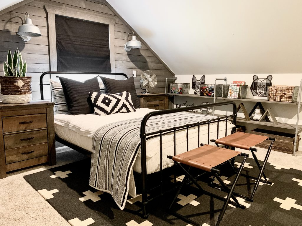 black and white bedding on bed in little boy's room