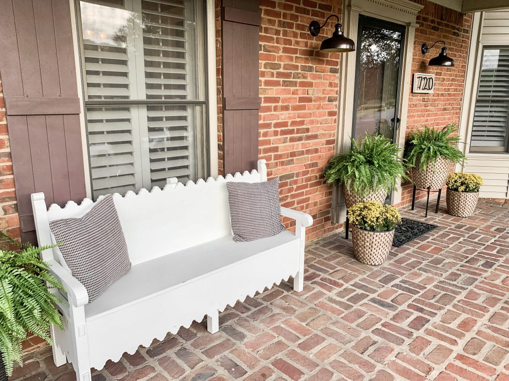 white bench and plants on porch
