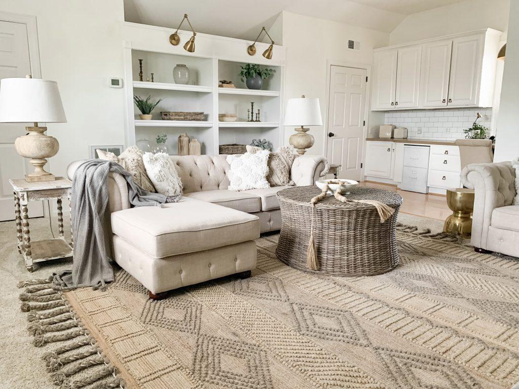 jute rug in bonus room under sofa